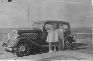 Gail and her school friends standing by her daddy's new car.  Dorothy Rose Laird is in the center, Gail on the right.