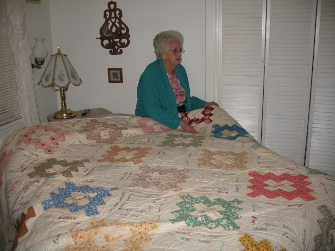Gail shows explains the names on the autograph quilt.