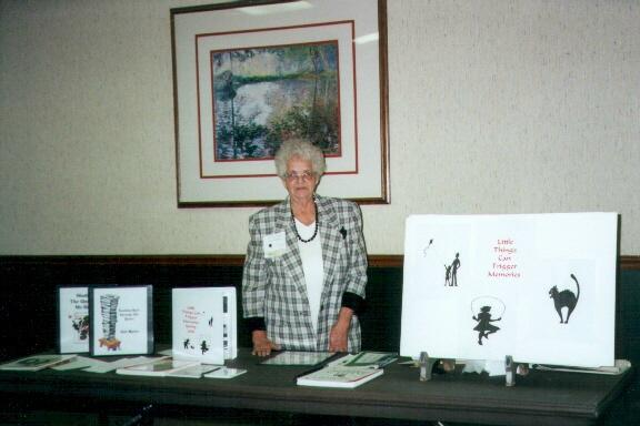 Gail Martin with one of her displays at the Kansas Author's Club.
