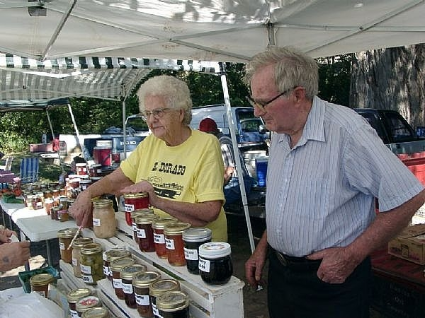 Gail and Clyde Martin with their jams and jellies at the farmer's market.