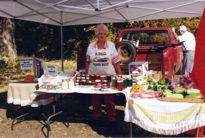 Gail with their farmers market booth