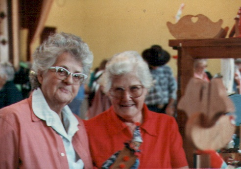 Sisters share a moment at the Eureka craft fair.