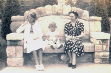 The older girl is Gail with her little sister, Carol, and their Aunt Bertha McGhee.