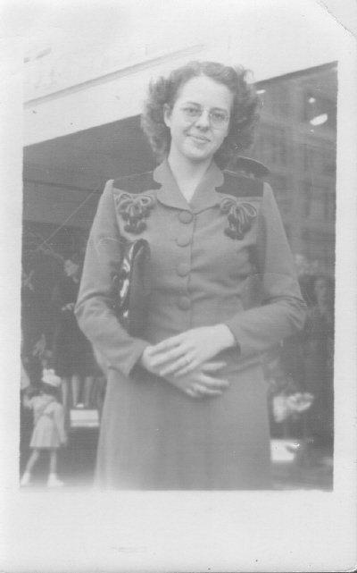 Photo taken by street photographer in Wichita, Kansas during WWII. Gail Lee McGhee in a pretty suit.