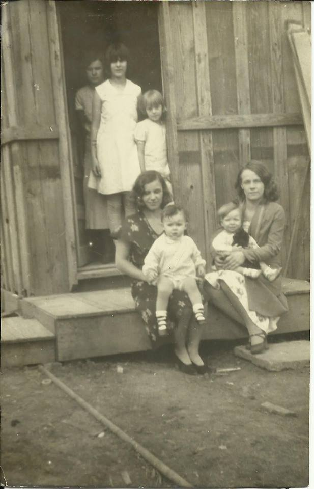 Here she is, little Gail McGhee, standing in the doorway with some of her older Bolte cousins.