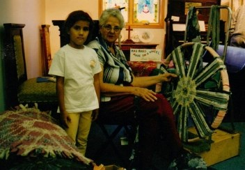 Here's Gail Martin and her granddaughter demonstrating the making of wagon wheel rugs.