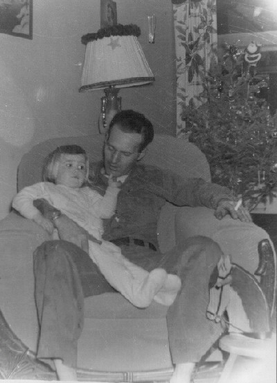 Clyde Martin with daughter, Cindy. Christmas time...