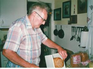 Here's Dad (Clyde Martin) slicing his homemade bread.