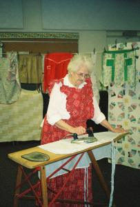 She displayed the vintage aprons on a clothesline around the room.