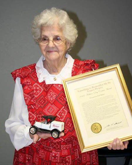 """Gail Lee Martin with her award certificate for her story """"My Mother's Apron"""""""