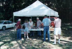 Gail and Clyde Martin with their farmer's market tent.