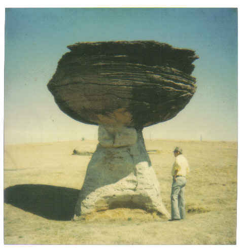Mom took this photo of Dad with a unique rock formation in Kansas.