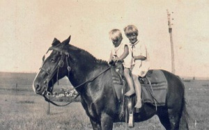 Gail McGhee and her older sister Melba on a horse in the 1930s.
