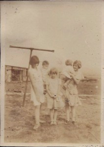 Young Gail McGhee in front, center. The shed in the background might be the wash house that the badger lived in, where he dug tunnels in the dirt floor.