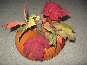 Here's Gail Lee Martin's fall pumpkin made from a dryer hose sprayed orange.