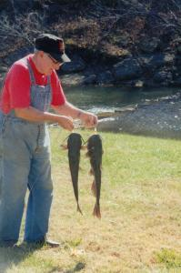 Clyde Martin with catfish caught at Sugar Valley Lake. (photo by Gail Martin)