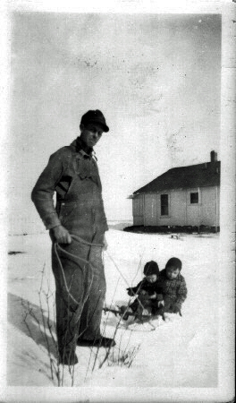 clarence_mcghee_pulling_toddlers_in_the_snow_at_a_lease_house_3_edited