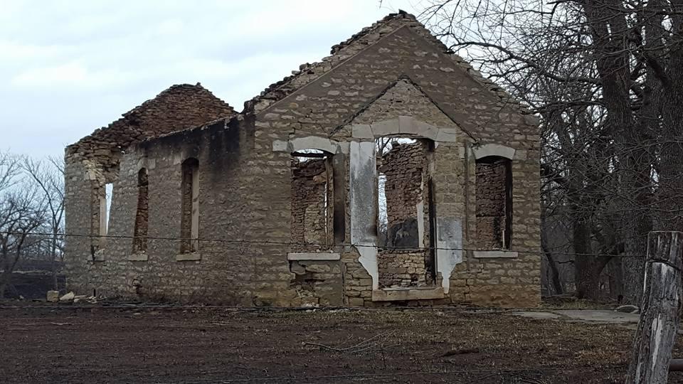 A photo by Mary Meyer of a burned school near Madison Kansas.