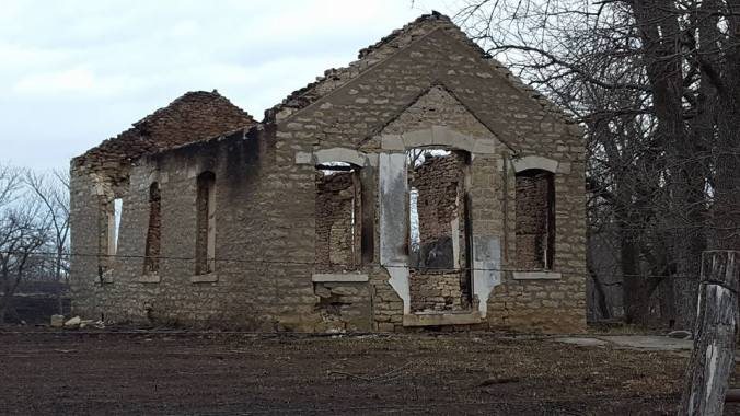 A photo by Mary Meyer of a burned school near Madison Kansas.
