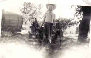 shirtless 1950s boy with saddle