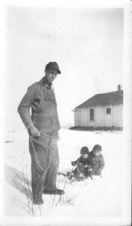 Clarence_McGhee_pulling_toddlers_in_the_snow_at_a_lease_house___karen_s_guess