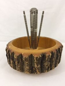 rustic wooden nutbowl with cracker and picks