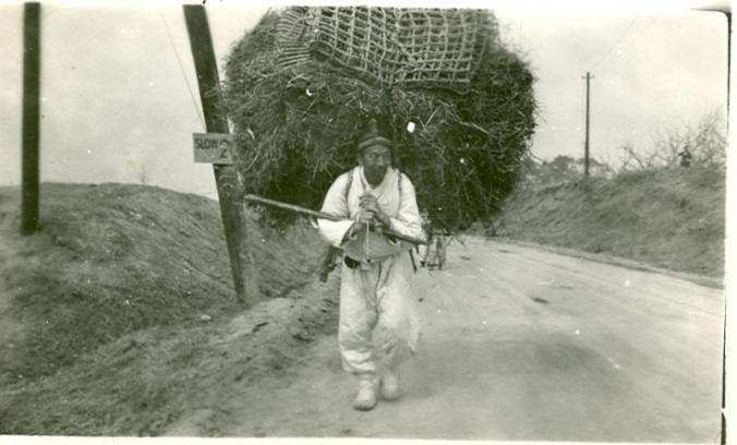korean farmer carrying heavy load - Photo by Monte Manka