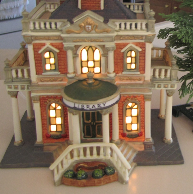 Christmas village library with lighted windows