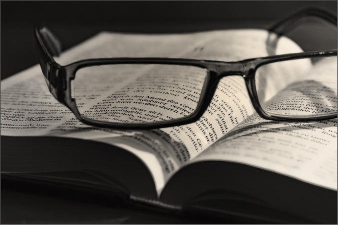 Reading glasses and a book