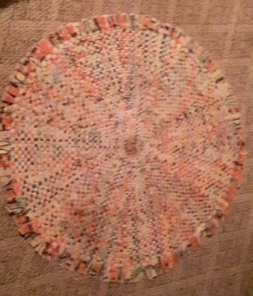 Pinks and peachy colors in a wagon wheel rug.