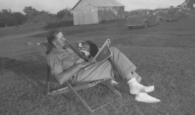 clarence mcghee in deck chair dog, car,