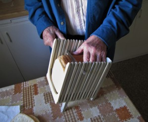 Clyde Martin slicing the homemade bread.