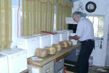 Clyde Martin making bread in his bread machines for the farmer's market