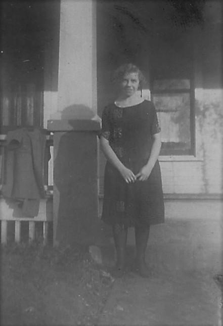 Bertha in a black dress.