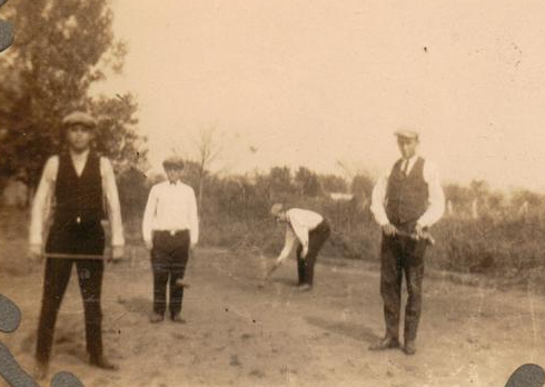 Tyro friends playing croquet
