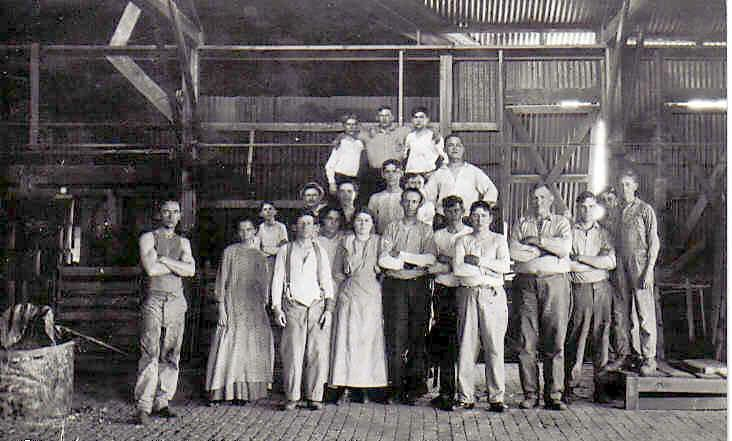 Glass factory - Clarence McGhee standing on pallet 54 kg too small